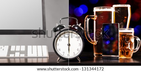 beer party after working day. Glasses of beer, office computer with clock and mobile phone