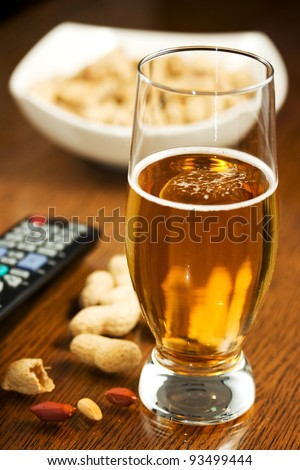 Beer, peanuts and TV remote