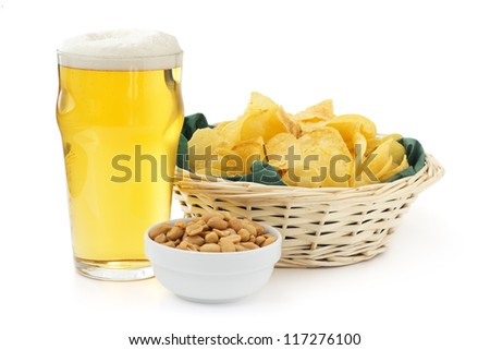 beer pint with peanuts bowl and basket of crisps