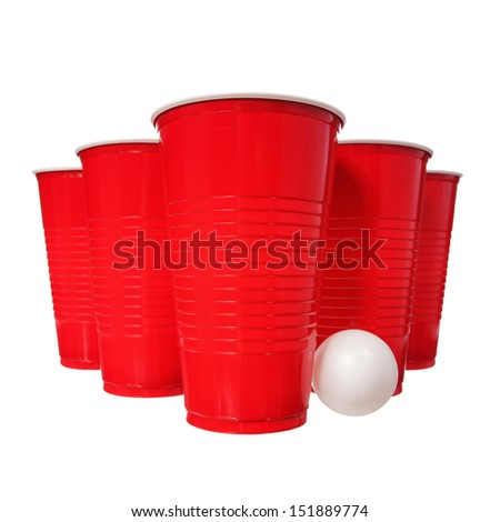 Beer pong. Red plastic cups and ping pong ball isolated on white background. Closeup
