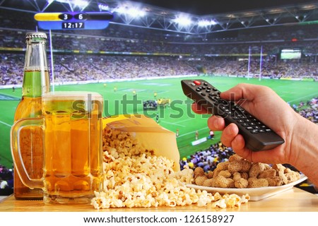 Beer Popcorn and Sport on TV - stock photo