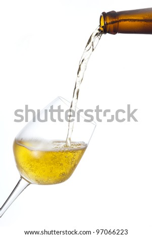 Beer pour in a glass isolated on white.