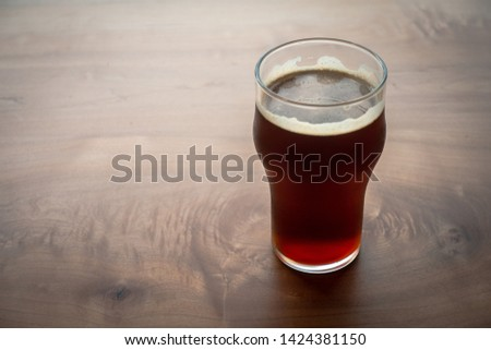 Beer Poured in Glass for Fine Dining #1424381150