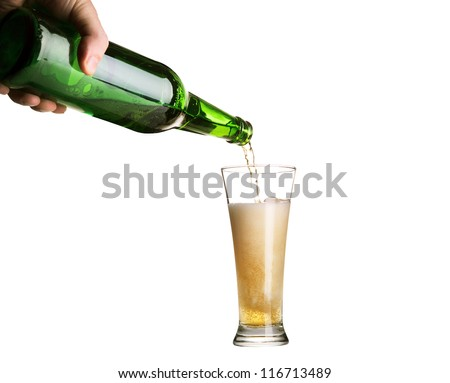 Beer pouring from green bottle into glass isolated on white