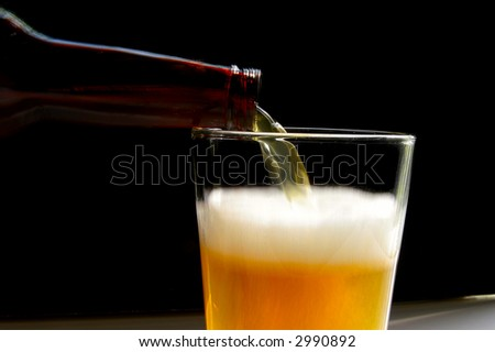 Beer pouring into a glass closeup(show shutter speed) - stock photo