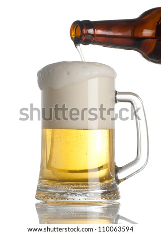 Beer pouring into glass on white