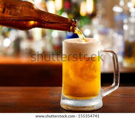 Beer Pouring Into Mug In A Bar