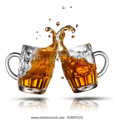 Beer splash in glass isolated on white - stock photo