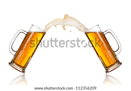Beer splashing out of glasses, isolated on white background