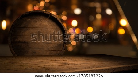 Beer style- bottle, beer in the glass and covers on wooden table. Free space for text. Top view Foto stock ©