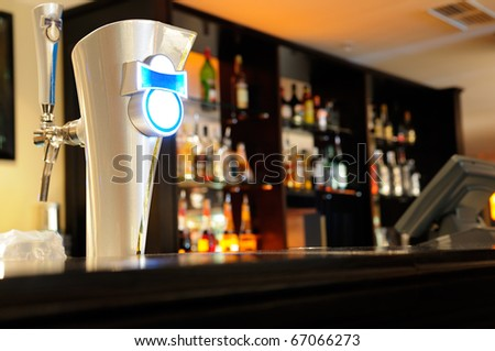 Beer tap in a bar.