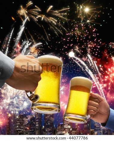 beer toasting with firework and skyline as background