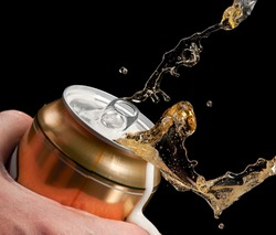 Beer up from a can, close up