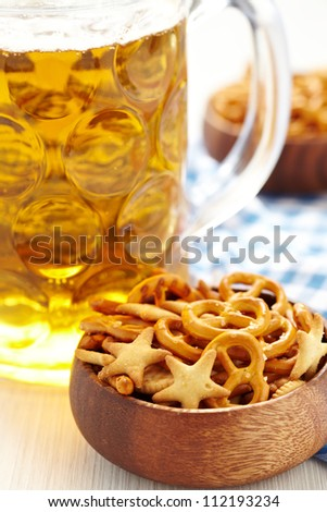Beer with Pretzels, Crackers and Nuts - stock photo