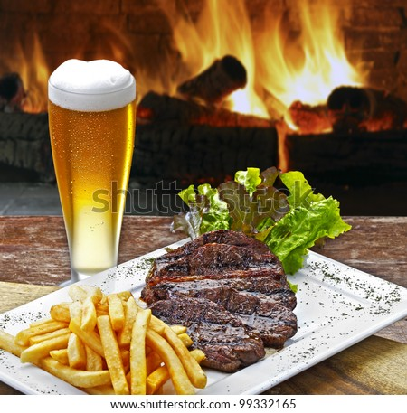 Beer with roast beef and potatoes