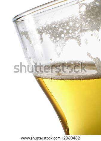 Beer within mug close-up over white background