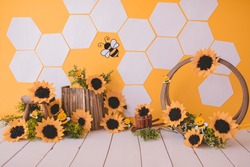Bees background with sunflower for photography studio