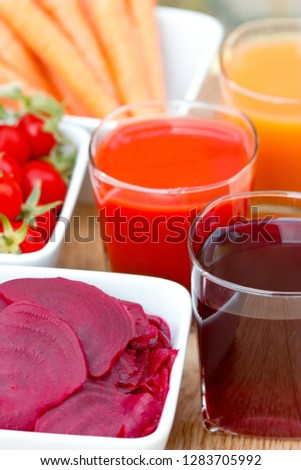 Beet and beet juice, slices of beet in bowl on table closeup