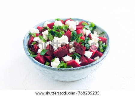 Beet and Feta Cheese Salad with Parsley isolated on white. Healthy vegetarian diet detox vegan raw food. Vegetable and protein food - beet and feta salad.
