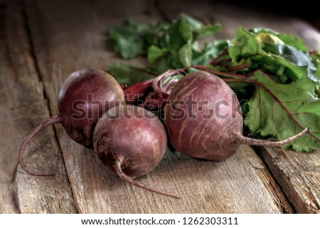 Beet, beetroot bunch on grey wooden background.