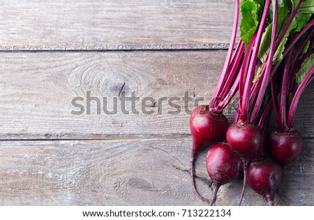 Beet, beetroot bunch on grey wooden background. Top view. Copy space.