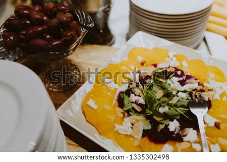 Beet carpaccio. Beet carpaccio with sauce on a white plate