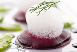 Beet root salad with asparagus on white plate