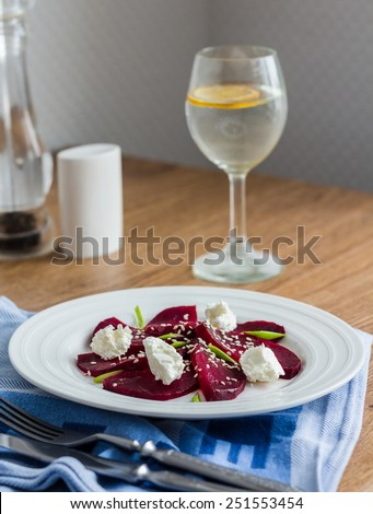 beet salad with goat cheese, garlic and sesame seeds, light dinner
