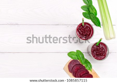 Beet smoothie with celery on white wooden background with copyspace