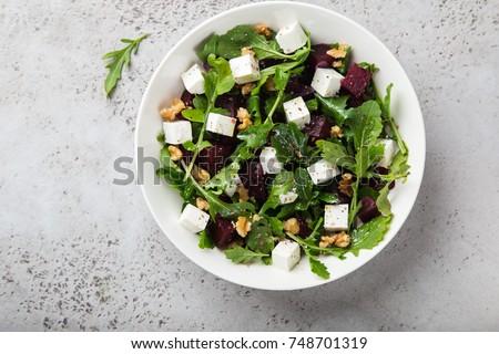 beetroot, arugula, feta cheese and walnut salad, top view