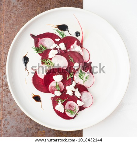 Beetroot feta salad fine dining with balsamic dressing and dill on ceramic white plate #1018432144