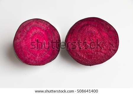 Beetroot halves on white table. Top view.