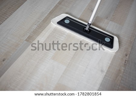 before and after cleaning concept - close up of microfiber floor mop on wooden background with copy space Stock foto ©