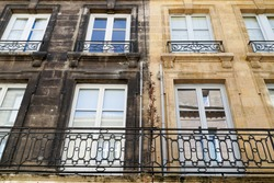 Before and After Outside cleaning facades building with difference between a wash clean house facade and dirty one