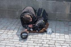 beggar, homeless with Dog near Charles Bridge, Prague, Czech republic