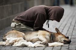 Beggar with dog on the street of Prague, Czech Republic