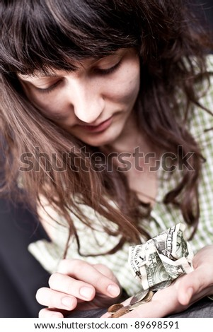 begging young woman with some money in her hands