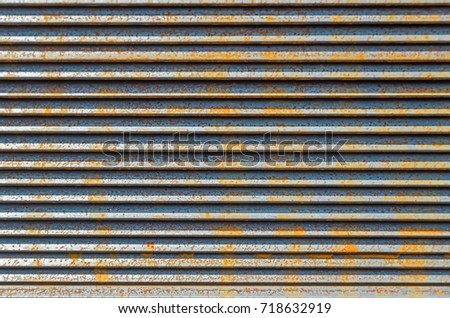 Beginner to rust metal L-bar angle in packs at the warehouse of metal products piled in the open air Stock fotó ©