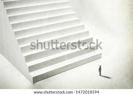 beginning a new challenge, man climbing big white stairs
