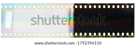 Photo of  Beginning of 35mm negative film strip, first frame on white background, real scan of film material with funny scanning light interferences on the film material.