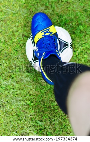 Beginning of the match. Footballer with the ball. Top view.