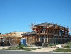 Beginning stages of construction of a house in a new suburb development