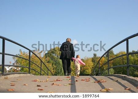 behind grandmother and baby on autumn bridge