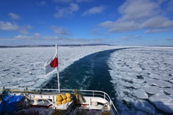 Behind the ice breaking ship for sightseeing the drift ice in winter at Hokkaido Japan.