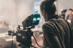 Behind the scene. Multiple camera setup. Cameraman shooting the film scene with camera in film studio. Group cinema set