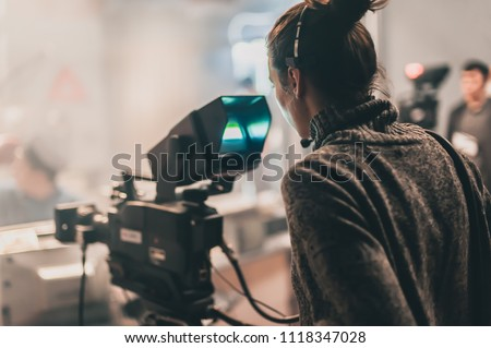 Behind the scene. Multiple camera setup. Cameraman shooting the film scene with camera in film studio. Group cinema set