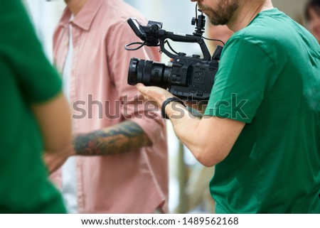 Behind the scenes of filming films or video products and the film crew of the film crew on the set in the pavilion of the film studio. #1489562168