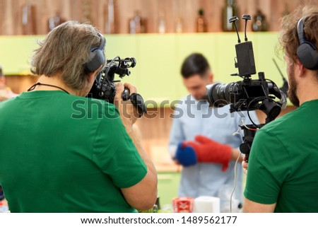 Behind the scenes of filming films or video products and the film crew of the film crew on the set in the pavilion of the film studio. #1489562177