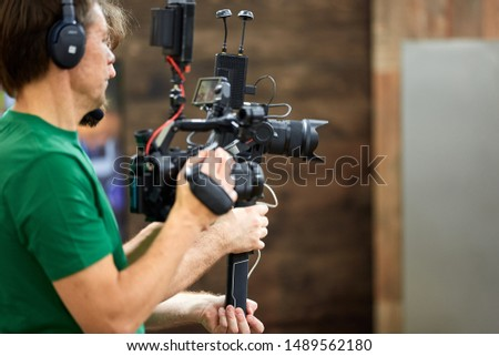 Behind the scenes of filming films or video products and the film crew of the film crew on the set in the pavilion of the film studio. #1489562180