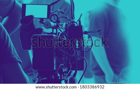 Behind the scenes of video recording or filming online movie by 8K high definition digital camera and professional monitor. And flare lighting set up with film crew team in the studio production. Stockfoto ©